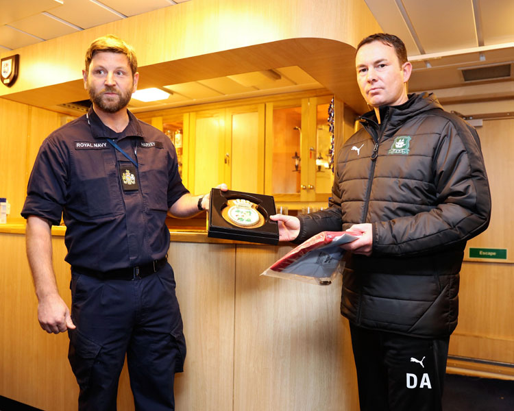 Warrant Officer Steve Harvey hands ship's crest to PAFC Manager Derek Adams