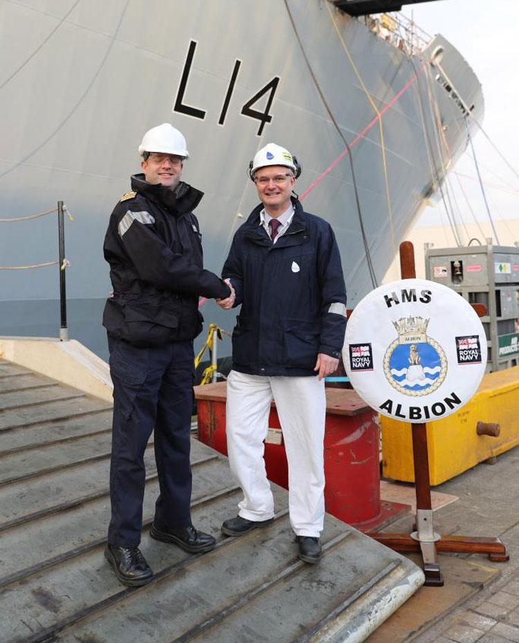 HMS Albion's captain Commander Stuart Yates and Babcock project manager James Morton
