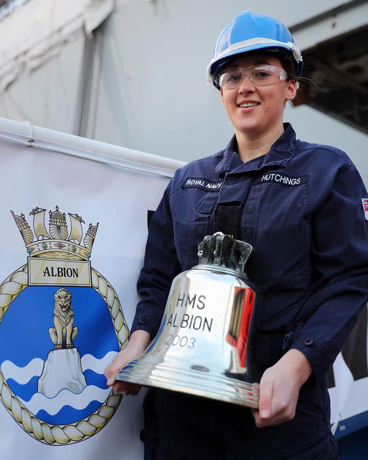 HMS Albion's ship's bell returns on board