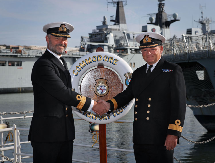 Commodore Paul Halton hands to Commodore Rob Bellfield
