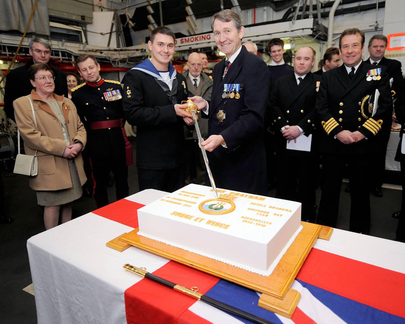 HMS Chatham decommissioning first CO Adm Ian Forbes cake cutting on baord