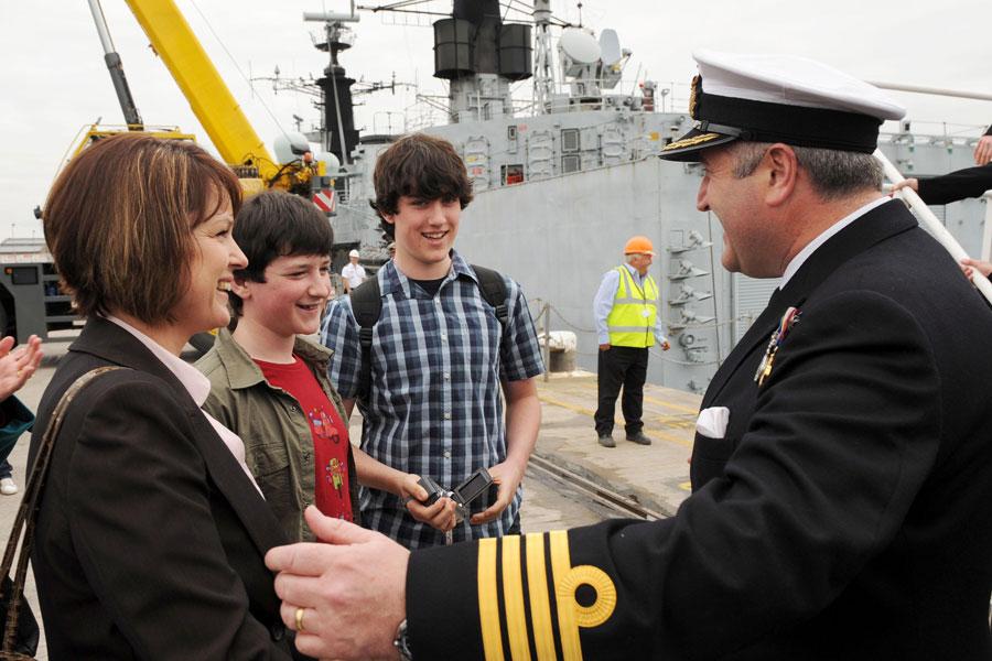 Captain Steve Dainton, CO HMS Cumberland and family.