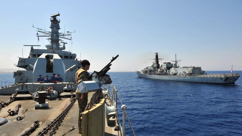 HMS Somerset, left, takes over duties from sister ship HMS Monmouth