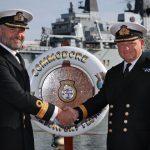 Commodore Paul Halton hands to Commodore Rob Bellfield