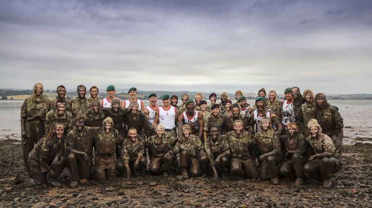The England Under 20s Women's Football squad train with the Royal Marines