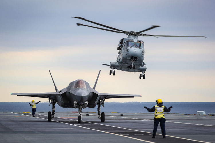 A Merlin Mk4 From 845 Naval Air Squadron takes off in the SAR role as UK test pilot Peter Wilson, prepres to take off to conduct the worlds first SRVL