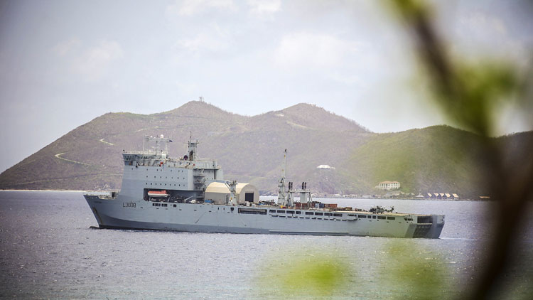 Royal Fleet Auxiliary ship, RFA Mounts Bay, returns to island paradise it helped rebuild