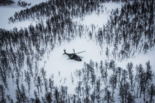 A Royal Navy Merlin Helicopter from the Commando Helicopter Force lands in a clearing in Norway