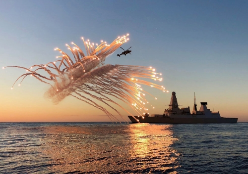 HMS Diamond's Wildcat helicopter conducts a test firing of her flares