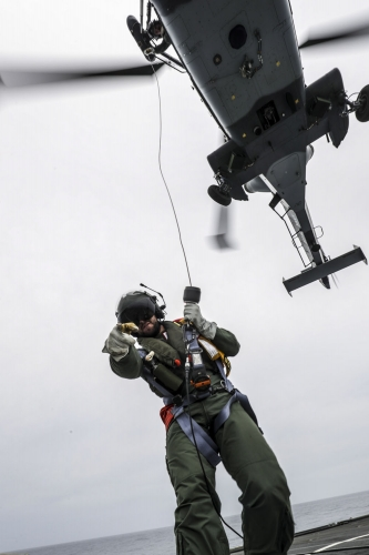 Pictured is Winchman James Watson during a winching serial on HMS SUTHERLAND