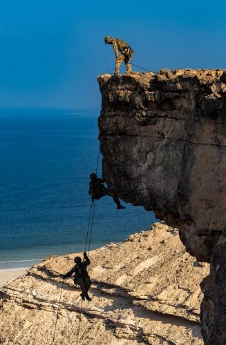 Charlie Company, 40 Commando Royal Marines conducting an abseil in Oman as part of Exercise Saif Saree 3