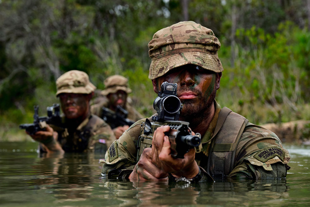 Marine John Allen of Alpha Company, 40 Commando Royal Marines with an Army Commando and a Marine patrolling in the river at Belize