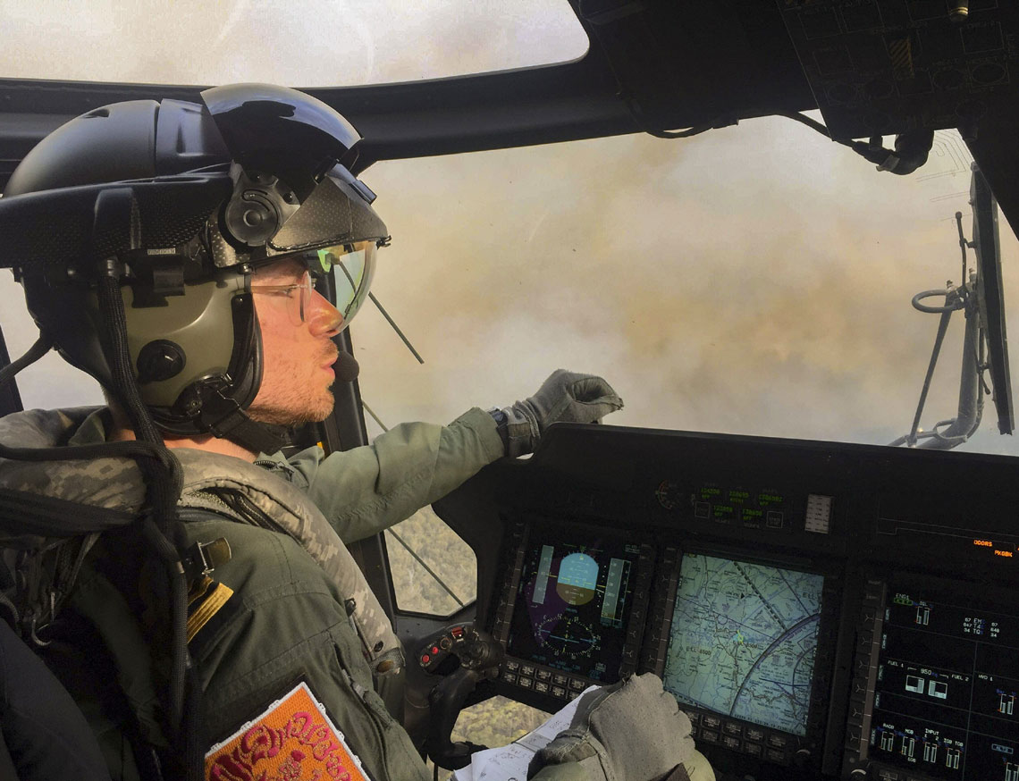Royal Navy pilot evacuates people trapped by Australian bush fires