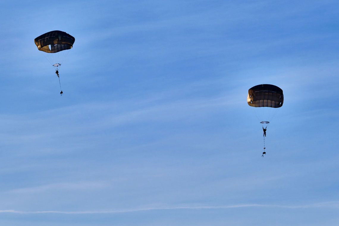 Royal Marines parachute deep behind enemy lines with American forces