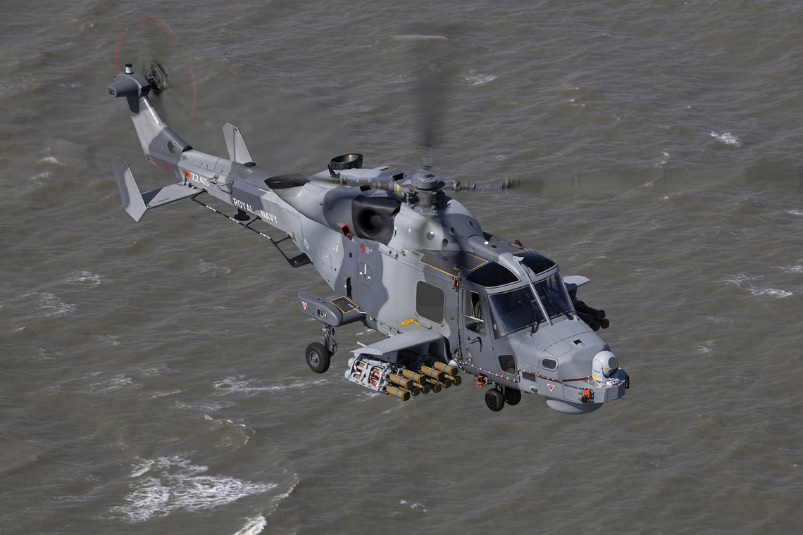 Royal Navy Wildcat helicopter fires the new Martlet missile