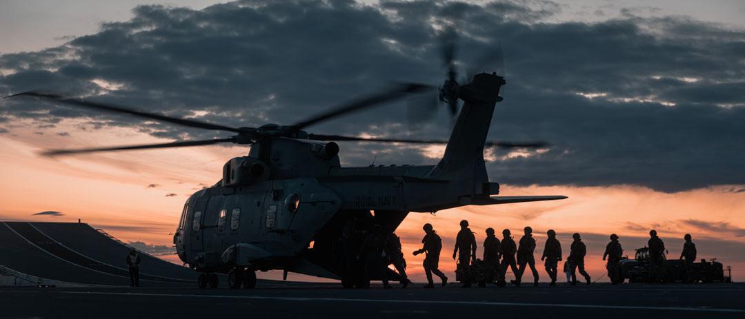 Royal Marines practice fast roping on HMS Queen Elizabeth