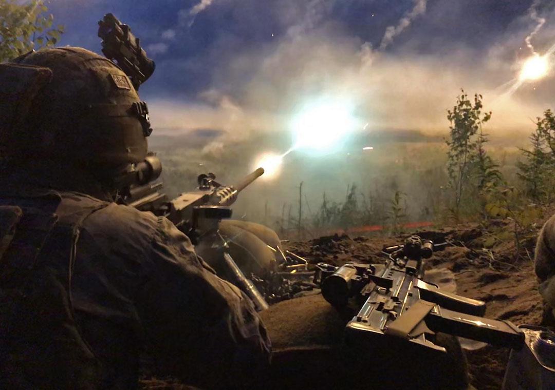 Royal Marines of 45 Commando firing a .50 calibre Heavy Machine Gun