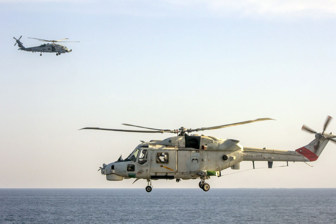 An Omani Super Lynx helicopter (foreground) and a US Navy Seahawk