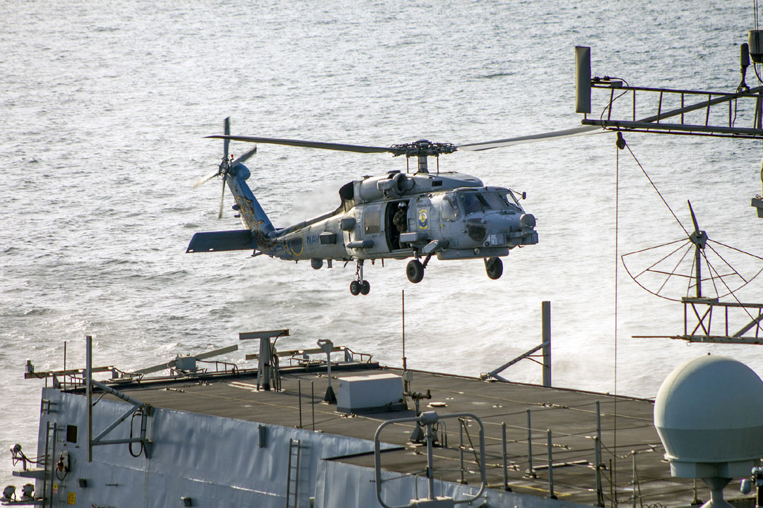 A US Navy Seahawk hovers over HMS Montrose