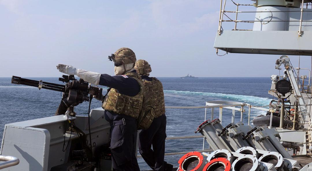A Minigun operator on HMS Montrose keeps their eyes on the target