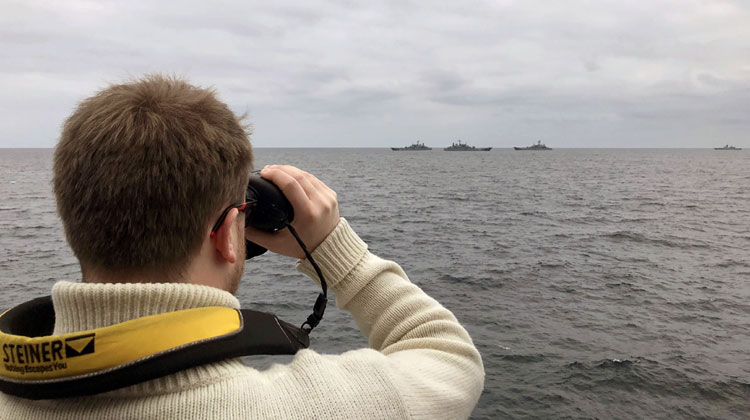 HMS TYNE officer observes the Russian units