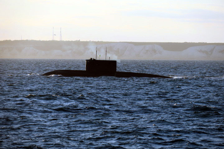A surfaced Algerian submarine passes the Kent coast while being monitored by HMS Severn