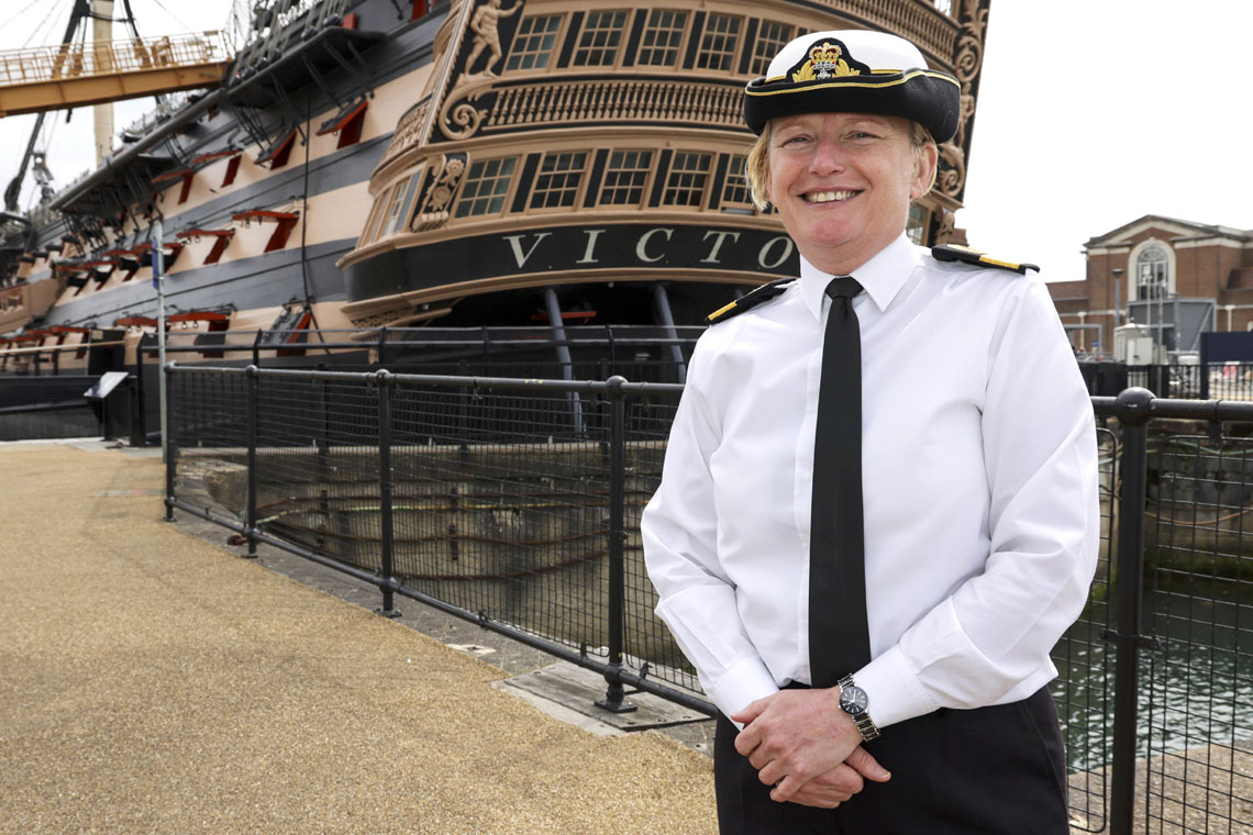 Commodore Terry in front of HMS Victory