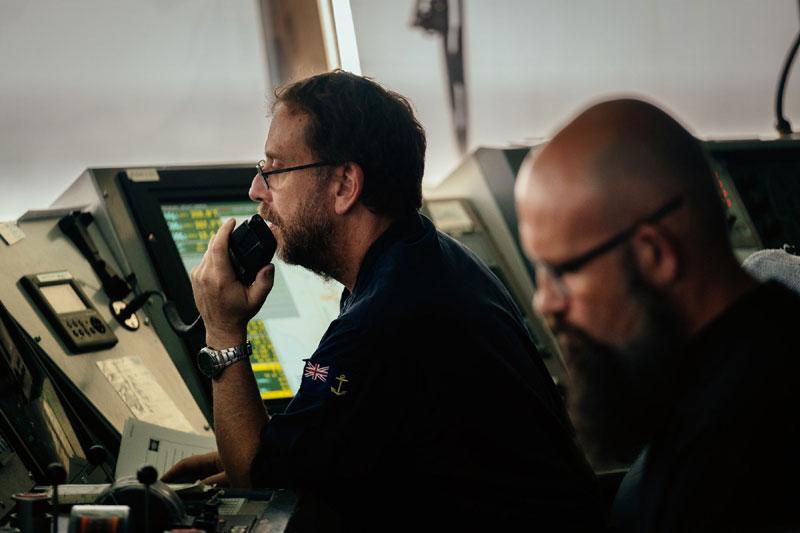 Sailors on RFA Wave Knight's bridge coordinate manoeuvres