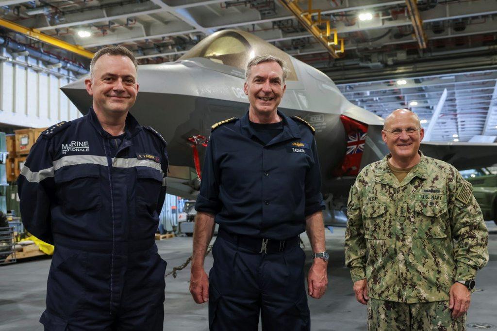 Admiral Radakin, Admiral Vandier, and Admiral Gilday in front of an F35B