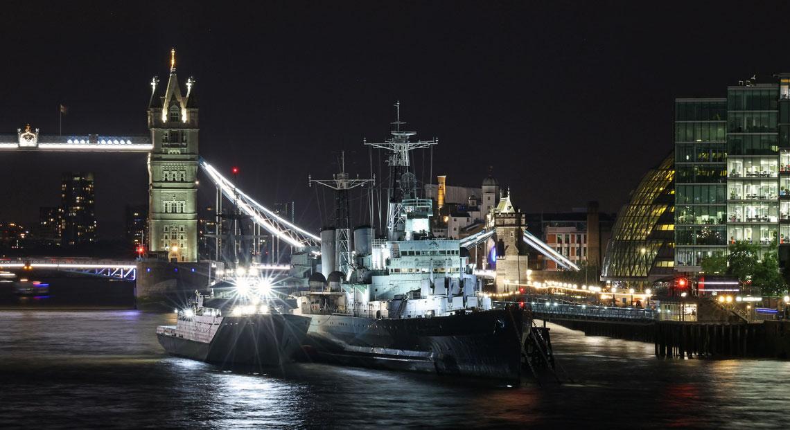 HMS Severn outboard HMS Belfast on the River Thames near Tower Bridge