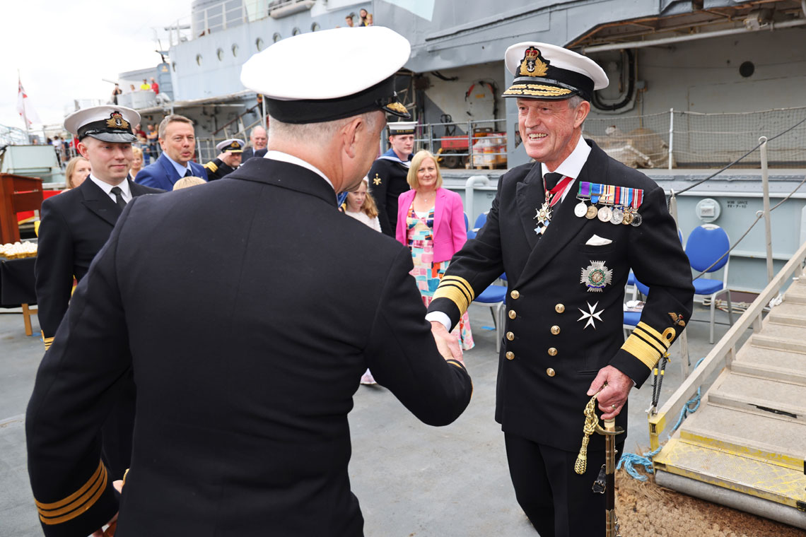 Commanding Officer of HMS Severn Philip Harper of HMS Severn greets Vice Admiral Sir Adrian Johns prior to the recommissioning ceremony