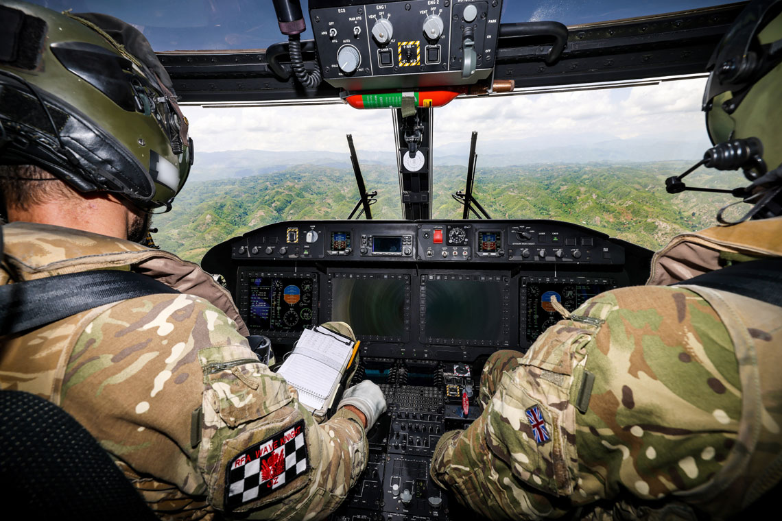 Royal Navy aviators are helping to survey the devastation in Haiti