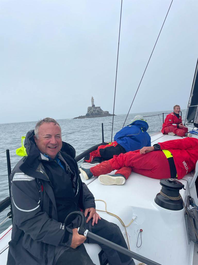 RORC Commodore, James Neville rounds the Fastnet Rock on his HH42