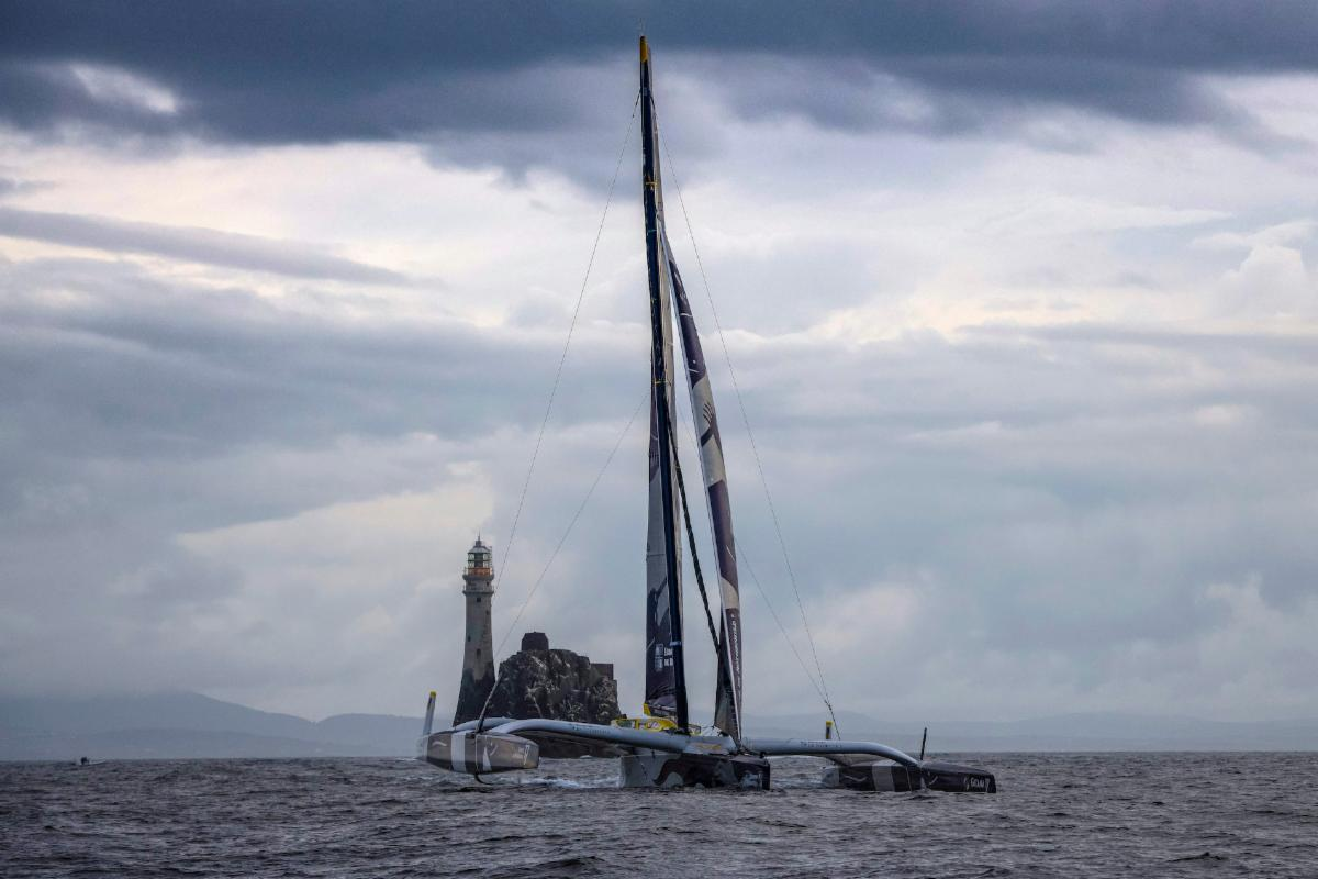 Maxi Edmond de Rothschild was first round the Fastnet Rock at 0800 BST in the Rolex Fastnet Race
