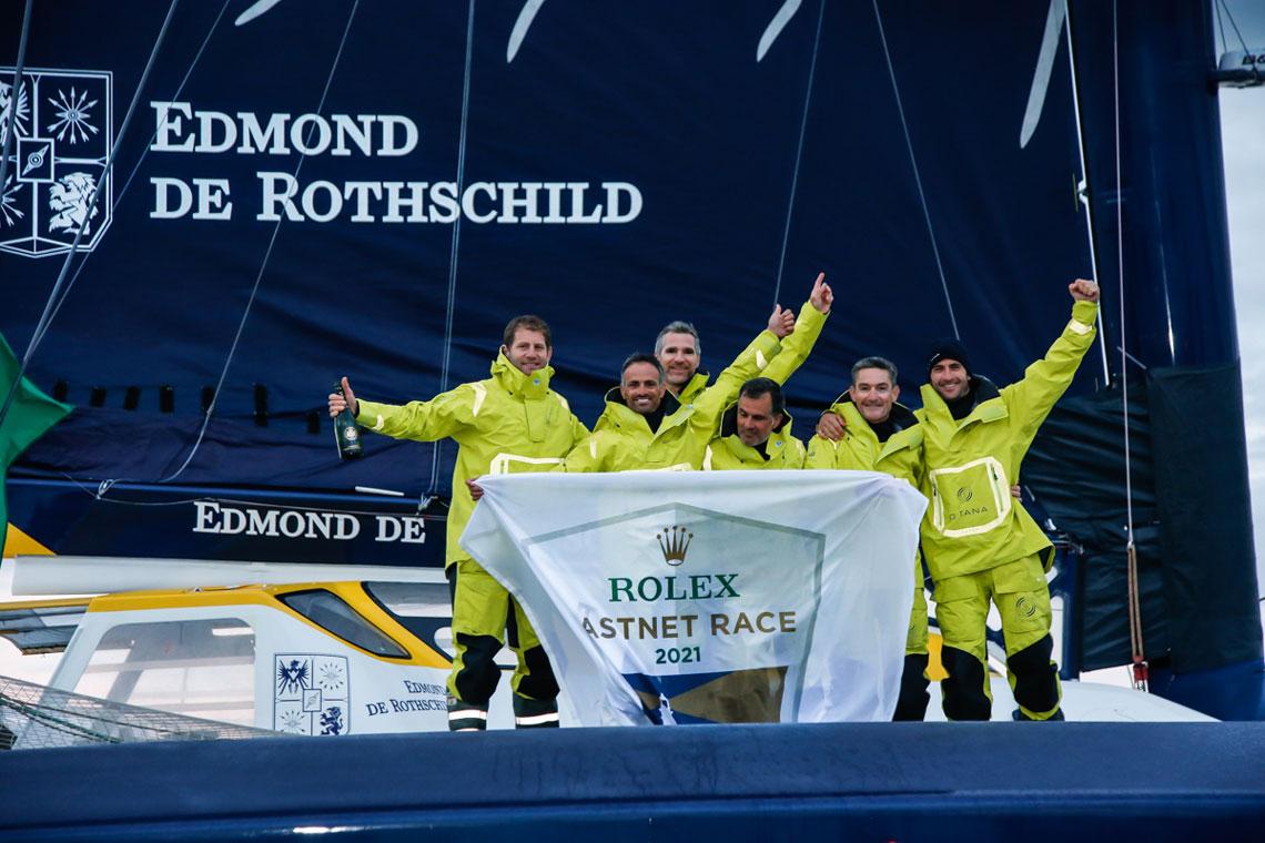 The Maxi Edmond de Rothschild crew celebrate their latest victory. © Paul Wyeth