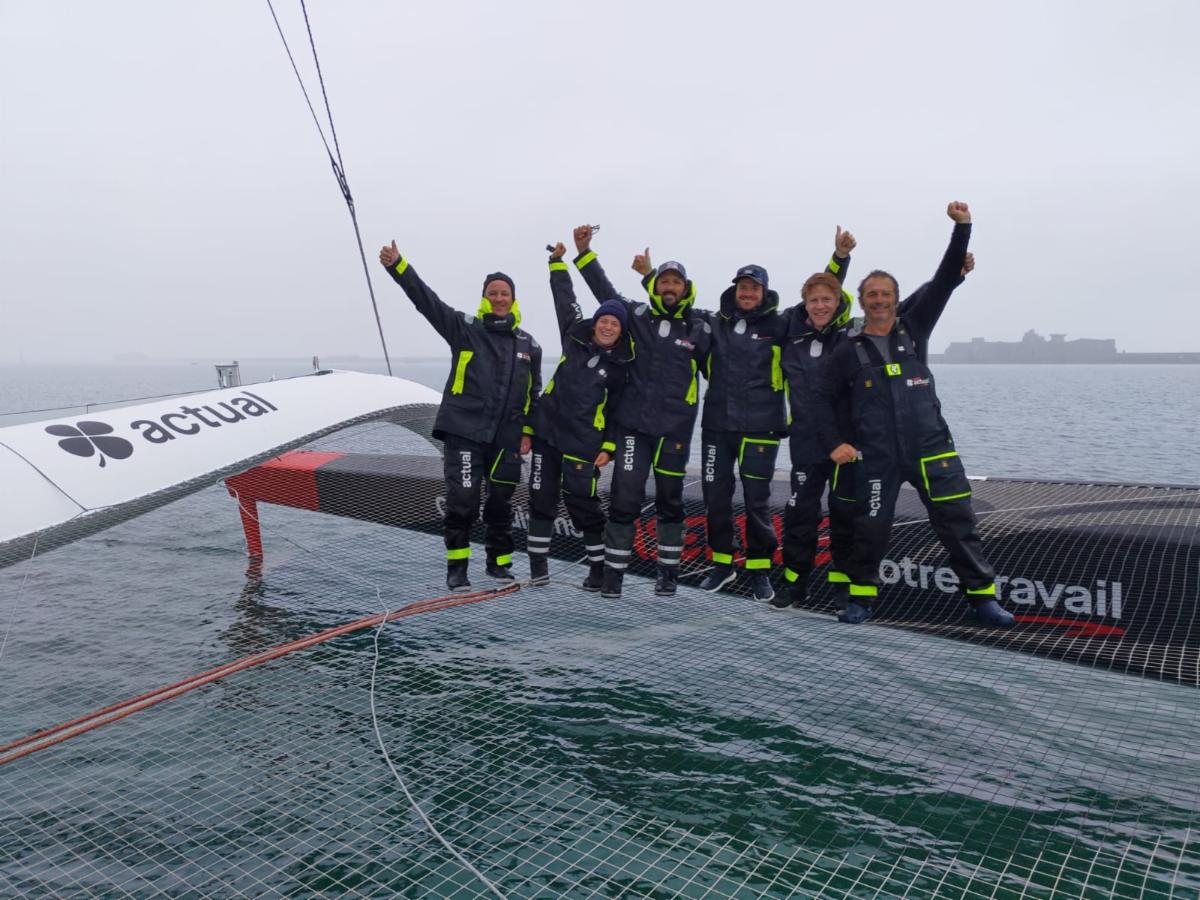 Yves le Blevec and the team on Ultime Actual celebrate after arriving at the finish