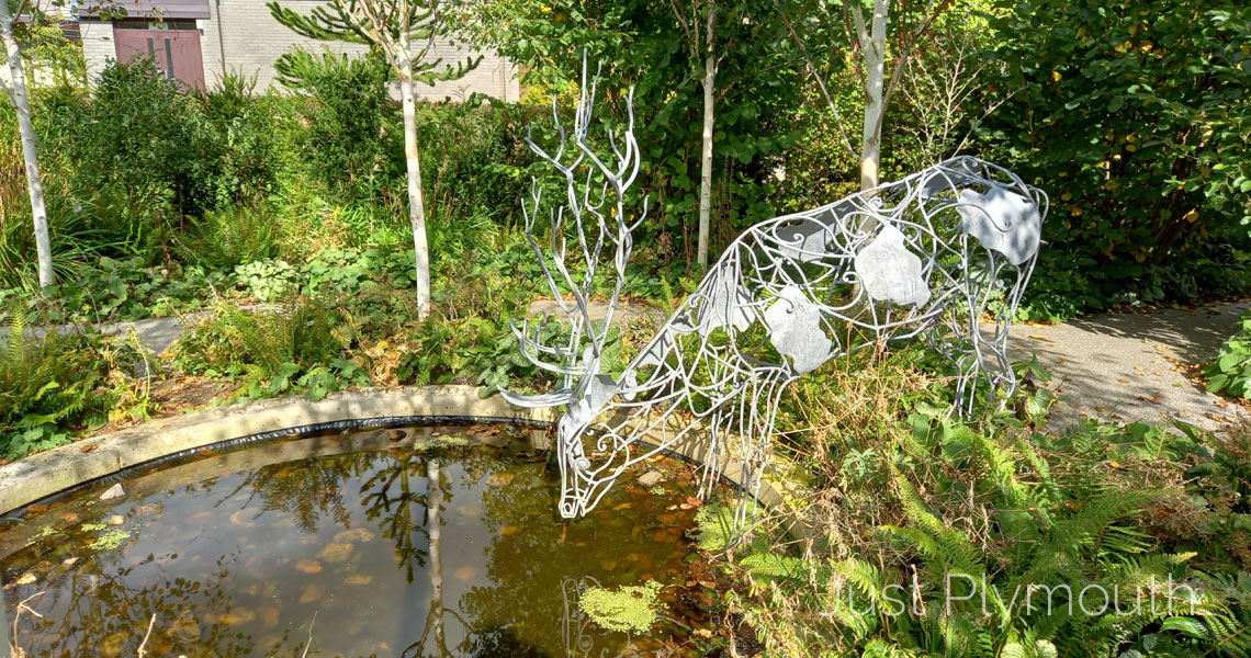 Buckfast Abbey garden with metal stag sculpture
