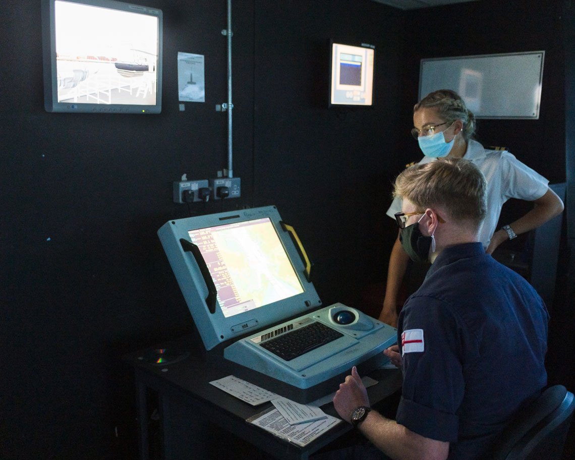 A cadet learns how to use the Royal Navy's WECDIS digital navigational system